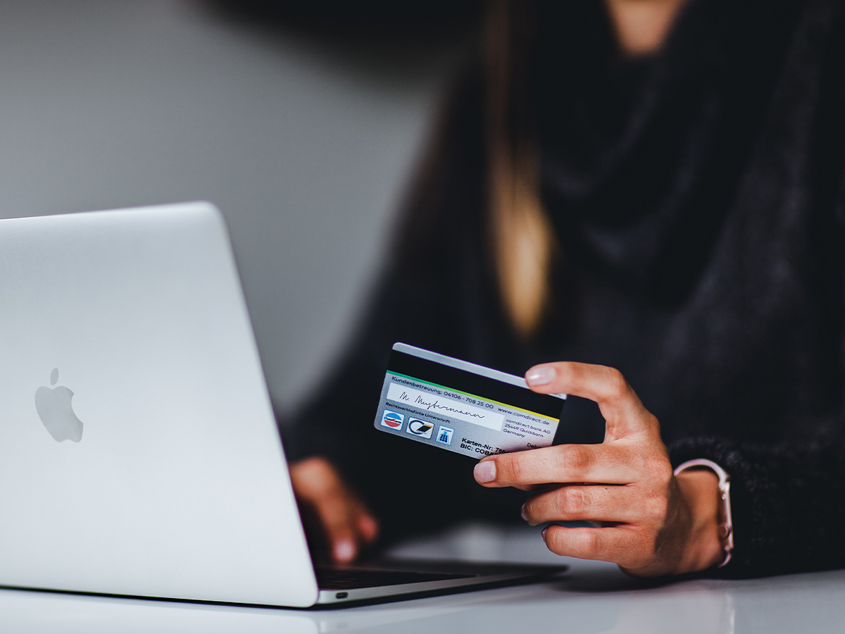 An image of a person buying something online.